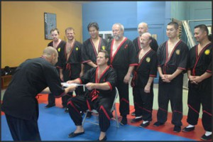 Photo - Sifu Jason Bolanz of Dallas, Texas was promoted to 2nd Level Technician by Master William Parker